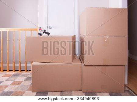 Stack Of Big Moving Cardboard Box In An Empty House