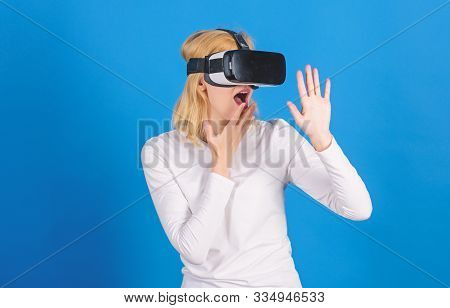 The Woman With Glasses Of Virtual Reality. Beautiful Woman Wearing Virtual Reality Goggles In Studio