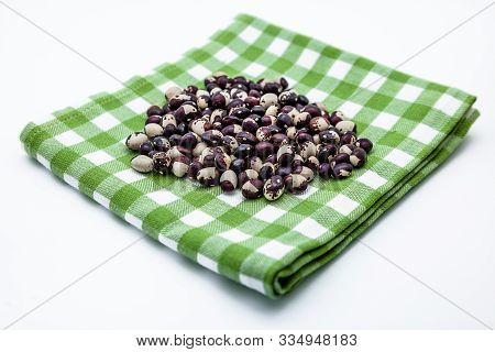 Black And White Beans On A Dishcloth