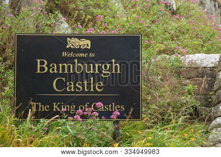 Welcome Sign Of Bamburgh Castle In Northumberland, England, Uk