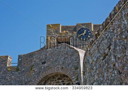 A Clock On The Walls Of Castle Cornet In St Peter Port, Guernsey, Uk