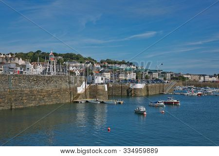 Scenic View Of A Bay In St. Peter Port In Guernsey, Channel Islands, Uk