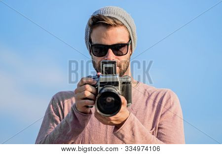 Photojournalist Concept. Hipster Reporter Taking Photo. Manual Settings. Travel Blogger. Professiona