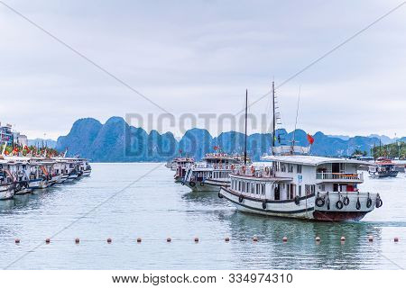 Halong Bay, Vietnam - March 6, 2019 : Tourist Ferry Boat In Halong Bay, Halong Bay Is A Unesco World