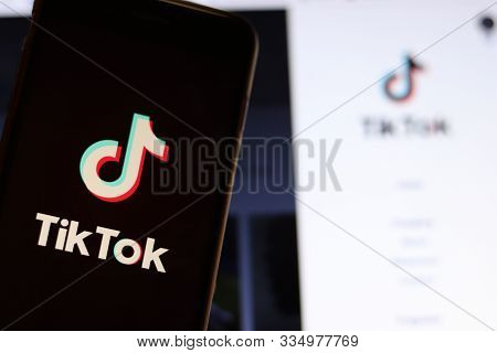 Los Angeles, California, Usa - 21 November 2019: Tiktok Logo On Phone Screen With Icon On Laptop On