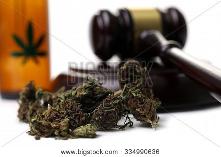 Marijuana Grass With Judge Hummer Isolated On White Background. Illegal Drug Trade Concept