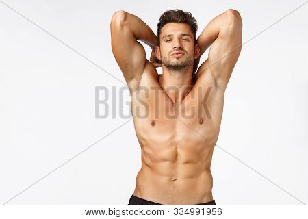 Sexy Self-assured, Handsome Bearded Young Sportsman, Athlete Posing Showing Perfect Body, Six-pack A