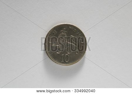 British Currency. Ten 10 10p Pence Coin Featuring A Crowned Lion. Isolated On A White Background. Mo