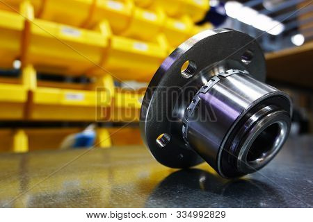 Concept New High Quality Original Spare Parts. New Original Wheel Hub With Bearing On Blurry Backgro