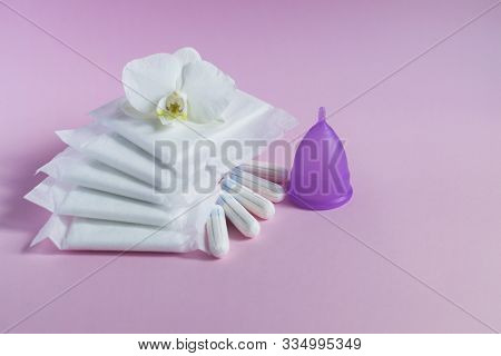 Female Intimate Hygiene. Cotton Feminine Pads And Tampons On Pink Background. Menstrual Cycle. Criti