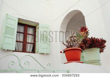 Traditional Architecture In Akrotiri Village On Santorini Island, Greece. White Houses, Green Shutte