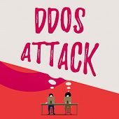 Handwriting text writing Ddos Attack. Concept meaning perpetrator seeks to make a network resource unavailable to user Two men sitting behind desk each one laptop sharing blank thought bubble. poster