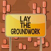 Word writing text Lay The Groundwork. Business concept for Preparing the Basics or Foundation for something Board ground metallic pole empty panel plank colorful backgound attached. poster