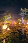 Loi Krathong Festival and Colorful Illumination Decorative at Night, Beautiful of Illuminated Light and Craftsmanship Lantern Decor of Loy Krathong Annual Event of Thailand. Traditional of Thai People poster
