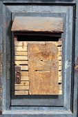 Old grungy and vintage wooden dropbox hung on a old door poster