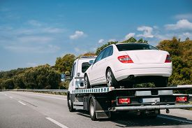 Car Service Transportation Concept. Tow Truck Transporting Car Or Help On Road Transports Wrecker Br