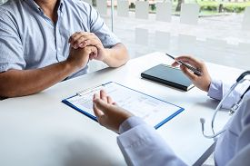Doctor And Patient Are Discussing Consultation About Symptom Problem Diagnosis Of Disease Talk To Th