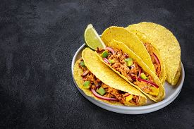 Cochinita Pibil Taco Shells, A Mexican Snack With Pulled Pork, Avocado And Marinated Red Onion, A Cl