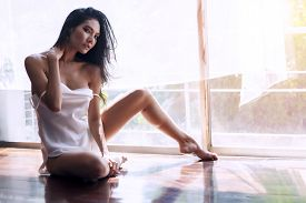 Attractive Sexy Woman Wear White Thin Pajamas Sitting Behind The Window Thinking About Something. Ch