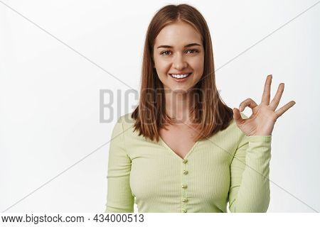 Okay. Smiling Blond Girl Shows Ok Zero Gesture, No Problem, Yes Or Alright, Approve Smth, Give Posit