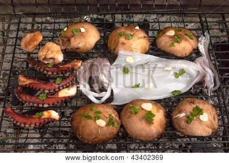 Mushrooms And Sea Food On Barbecue, Greece.