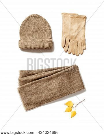 Autumn Warm Clothes, Knitted Hat, Wool Scarf And Suede Gloves Isolated On White. Warm Wear For Cold