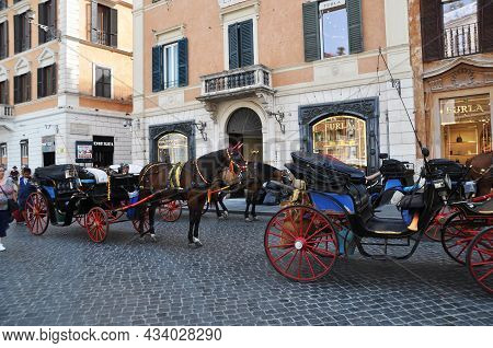 Horse Carriages On The Streets Of Rome. Tourists Take Walks Along The Streets In Beautiful Carriages