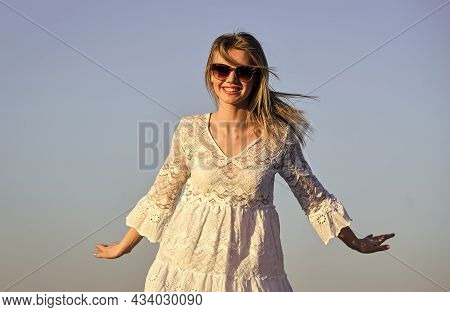 Happiness Inside Me. Happy Young Woman Posing Over Blue Sky. Pretty Young Beautiful Woman In Sunglas