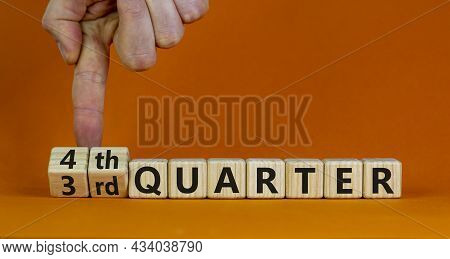 From 3rd To 4th Quater Symbol. Businessman Turns Cubes And Changes Words '3rd Quater' To '4th Quater