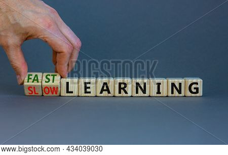 Fast Or Slow Learning Symbol. Businessman Turns Cubes, Changes Words 'slow Learning' To 'fast Learni
