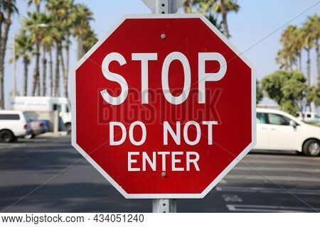 Red Stop Sign. Stop sign reads DO NOT ENTER.