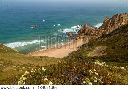 Cliffs on the shore of Atlantic ocean in Cabo da Roca (Cape Roca) in Portugal. Westernmost point of continental Europe