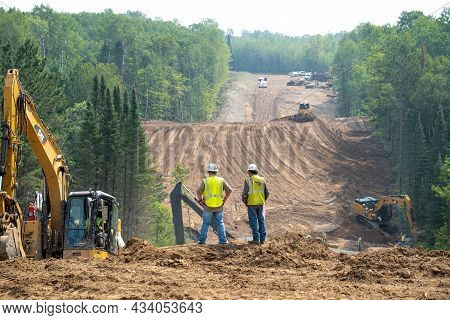 Cass Co, Mn - 6 Aug 2021: Workers Overlook The Enbridge Line 3 Oil Pipeline Construction Site In Min