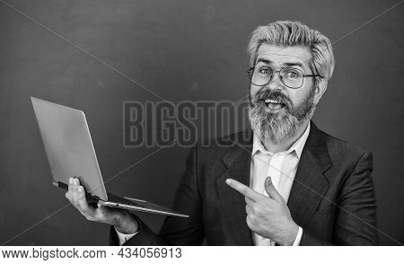 Provide Accurate Current Information. Teacher Wear Eyeglasses Hold Laptop Surfing Internet. Bearded
