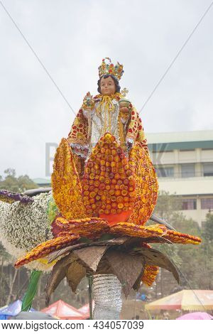 Santo Niño Statue On Top Of Petals Made Of Everlasting Flowers Displayed At Flower Festival In Bagui
