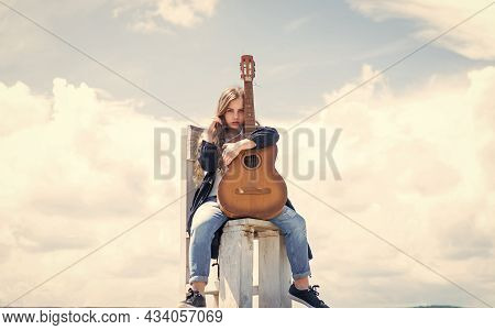 Cheerful Day Dreamer. Fashion And Beauty. Her Perfect Hairstyle Look. Music Lover. Child With Guitar