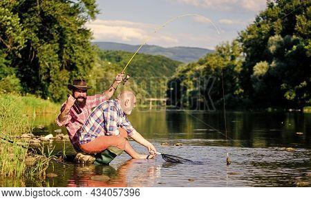 Fishing Activity Concept. Retired Dad And Mature Bearded Son. Big Game Fishing. Happy Fishermen Frie
