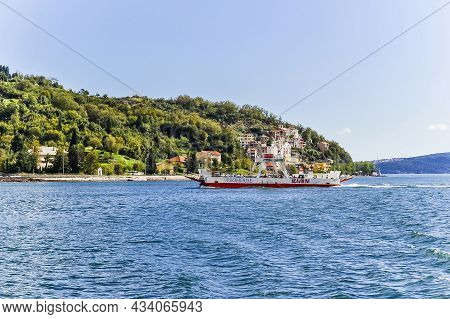 Kamenari, Montenegro - July 25, 2021: Beautiful View Of The Bay Of Kotor And Regular Passenger Ferry