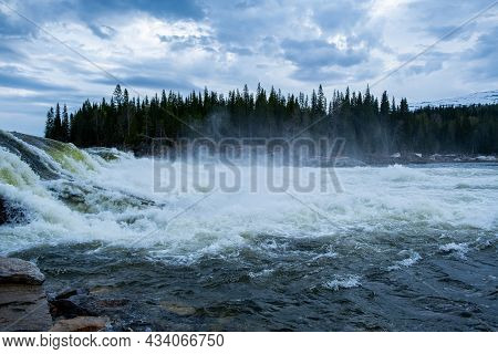 Steamy River On The Background Of The Forest Nature Of Scandinavia