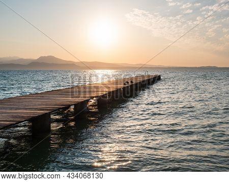 Lake Garda Jetty At Sunrise Called Il Pontile Di Sirmione In Summer