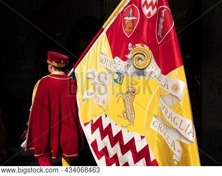 Siena, Italy - August 15 2021: Standard Bearer Or Flag Bearer Of The Shell Or Seashell Contrade, A P