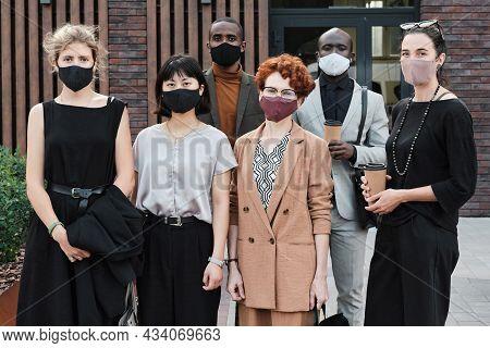 Horizontal Medium Long Group Portrait Shot Of Unrecognizable Multi-ethnic Men And Women Wearing Prot