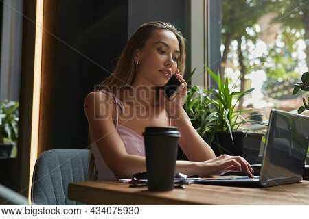 Beautiful Young Asian Business Woman Sitting At Cafe, Working On Laptop. Pretty Female Sitting At Ta