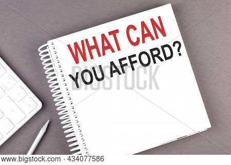What Can You Afford Text On The Notebook With Calculator And Pen,business