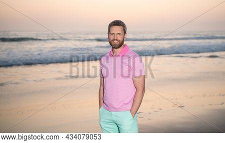 Caucasian Guy On Sunrise Beach. Bearded Man In Shirt. Summer Fashion Style. Summer Vacation