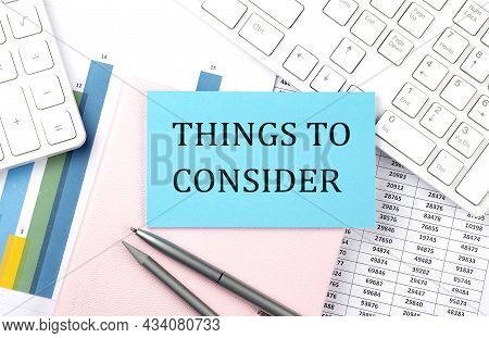 Things To Consider Text On Blue Sticker On Chart With Calculator And Keyboard,business