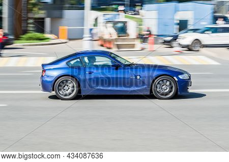 Bmw Z4 Coupe E86 In Fast Motion On City Street. Speeding In The City Is Not Permissible. Blue Color