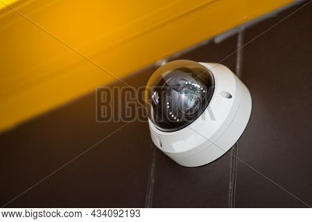 Close Up Of Modern Cctv Camera On A Wall. Concept Of Surveillance And Monitoring.