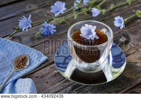 Drink Made Of Chicory Roots In Thermo Glass Cup, Blooming Chicory Plants, Blue Linen Napkin And Spoo