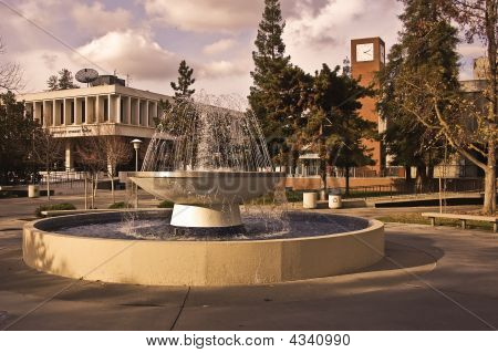 This is a view of the Student Union and bookstore at the California State University at Fresno. a large public university in California. poster
